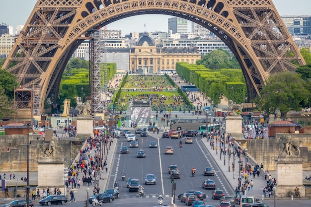 Eiffel tower and champ de mars. many cars and tourists on the jena bridge