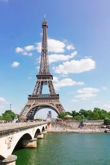 Eiffel tower over seine river at summer day, paris,  france