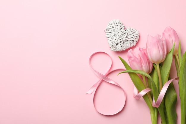 Eight, heart and tulips on pink background, space for text
