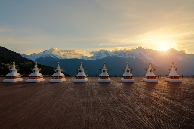 Eight pagoda at feilai temple with meili snow mountain, kawagebo peak in yunnan, deqin, china