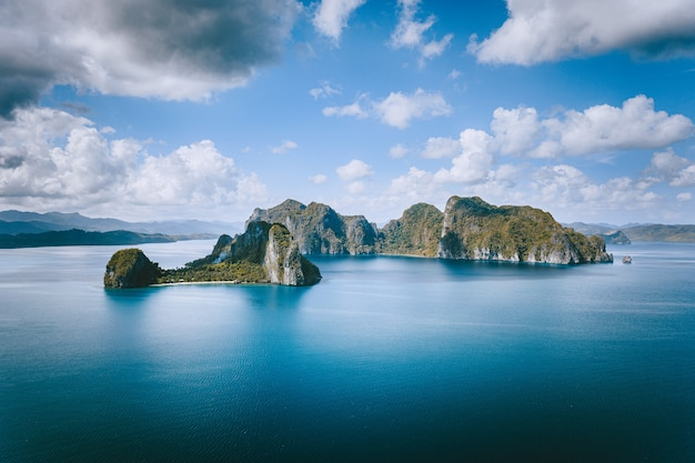 El nido, palawan, philippines. panoramic aerial view lonely tourist boat in open sea with exotic
