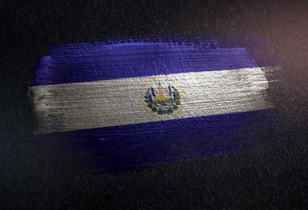 El salvador flag made of metallic brush paint on grunge dark wall