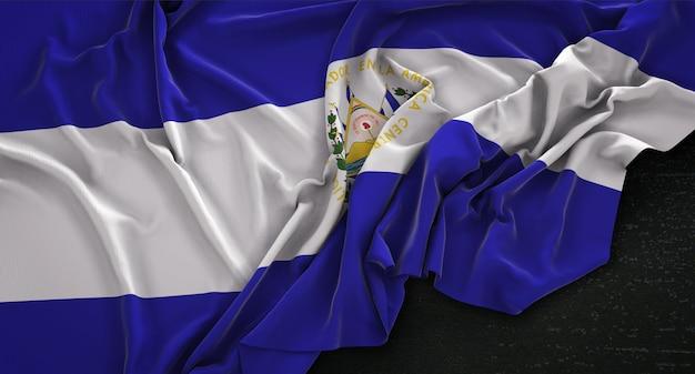 El salvador flag wrinkled on dark background 3d render
