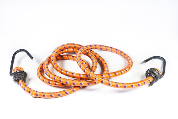 Elastic rope with metal hooks on white background.