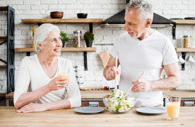 Elder couple cooking in the kitchen