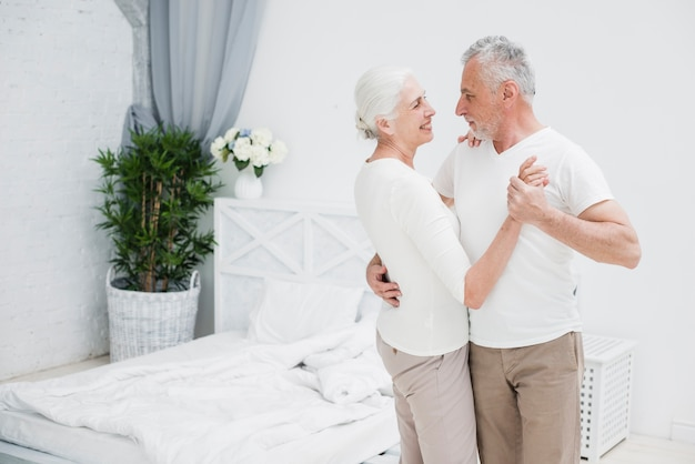 Elder couple dancing in the bedroom