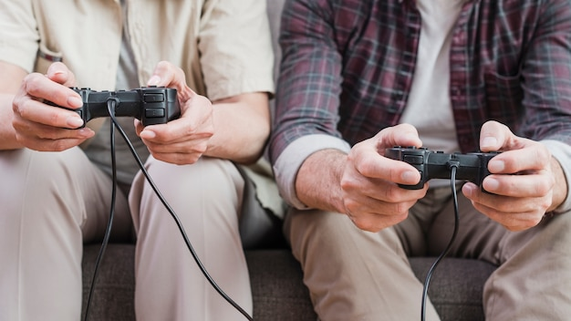 Elder couple playing video games together