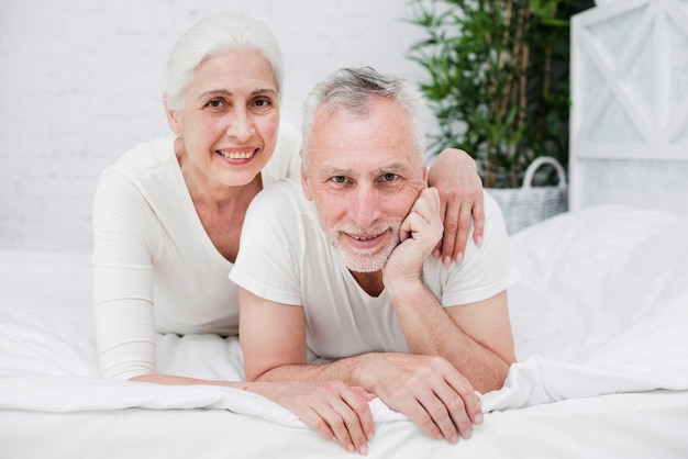 Elder couple posing for a photo
