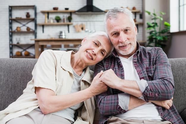 Elder couple posing for a photo