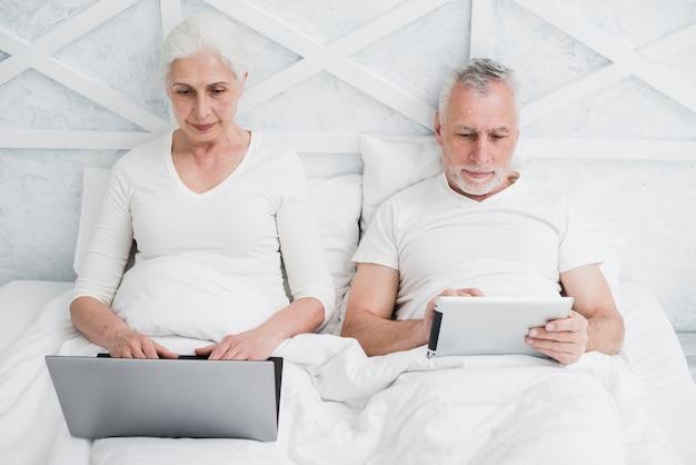 Elder couple using a laptop