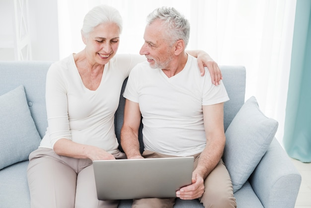 Elder couple using a laptop