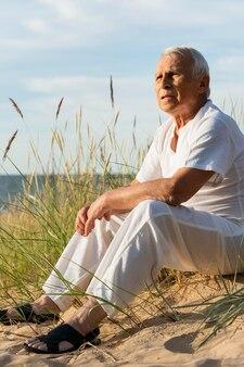 Elder man enjoying the view at the beach
