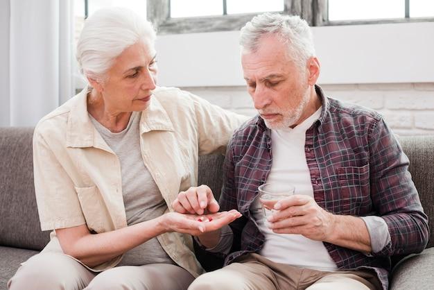 Elder man having his medicines