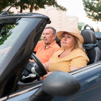 Elder tourist couple on vacation in car