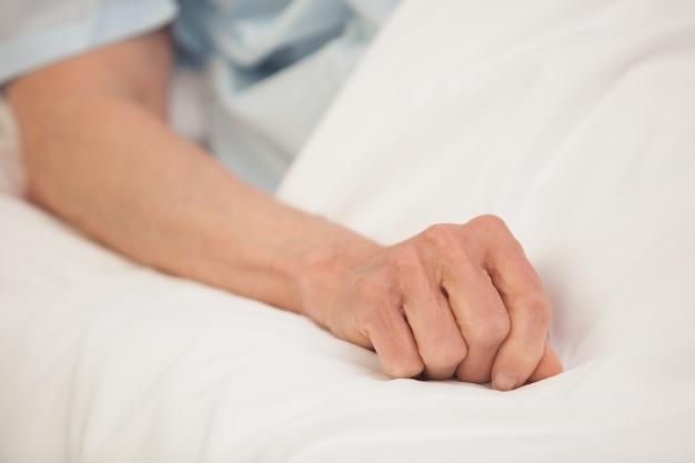 Elderly arm in hospital bed