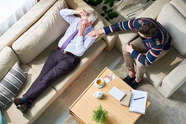 Elderly businessman crying at therapy session