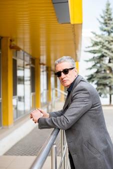 Elderly businessman posing