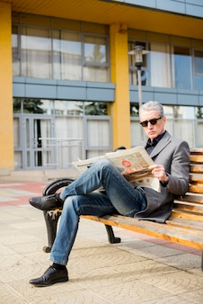 Elderly businessman reading newspaper