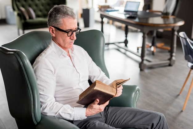 Elderly businessman reading