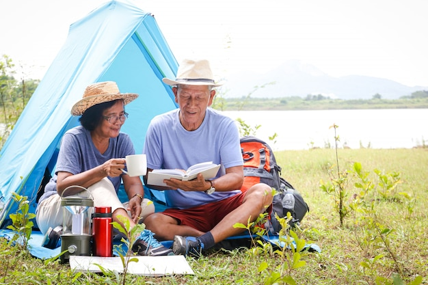 Elderly couple camping in nature