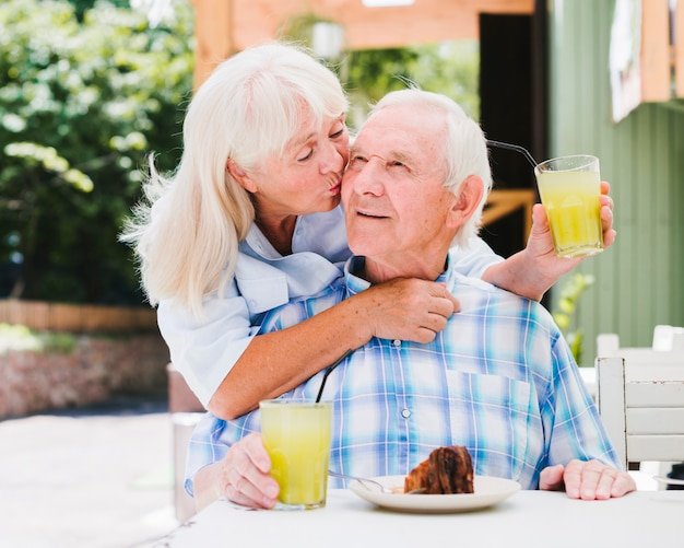 Elderly couple having breakfast outdoors