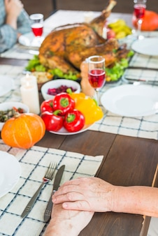 Elderly couple sitting at festive table