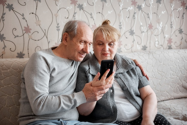 An elderly couple talks on a video call with their family during the quarantine
