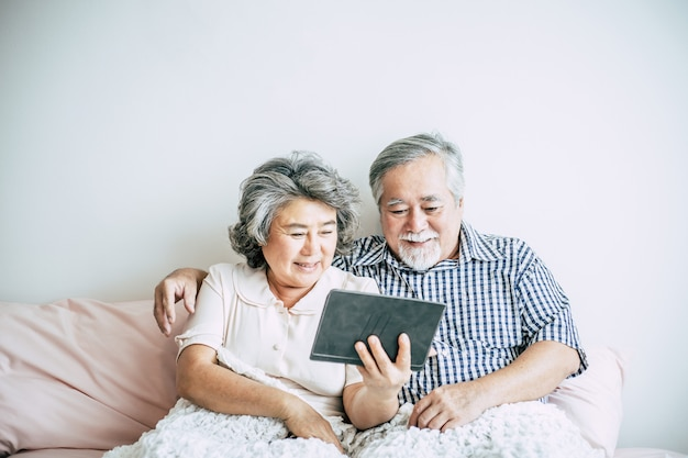Elderly couple using tablet computer