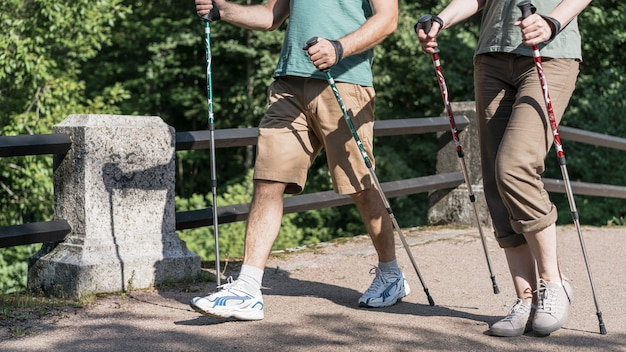 Elderly couple using trekking poles