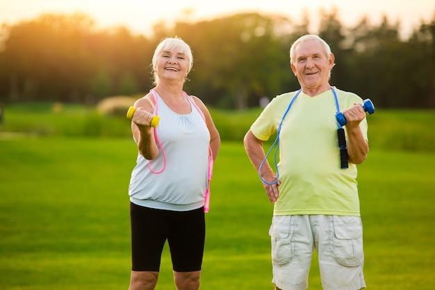 Elderly couple with dumbbells