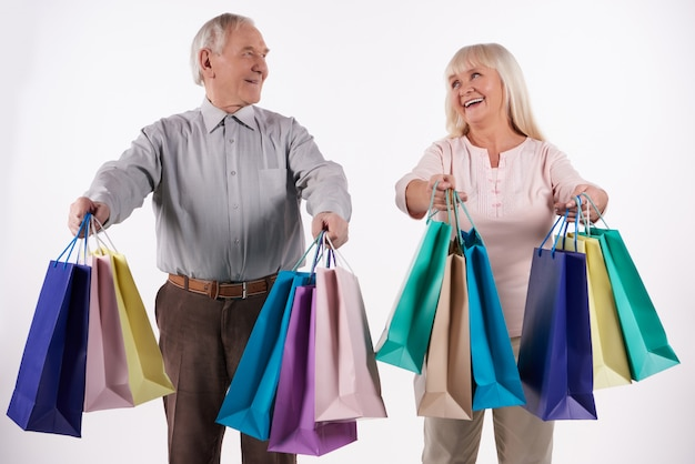 Elderly couple with packages go shopping.