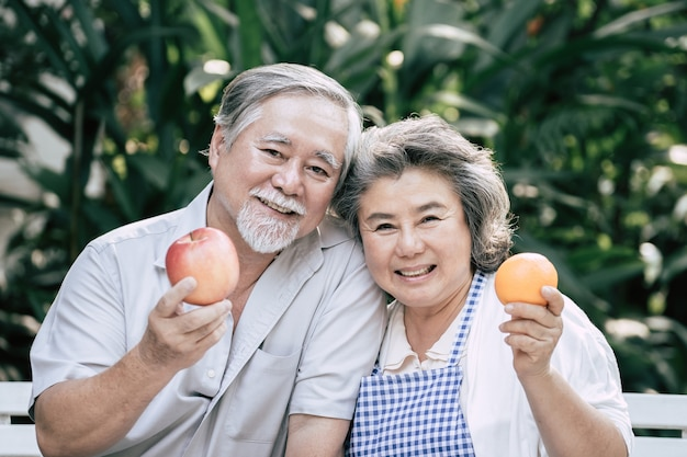 Elderly couples cooking healthy food together