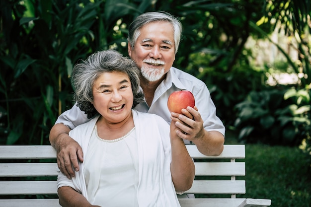 Elderly couples playing and eating some fruit