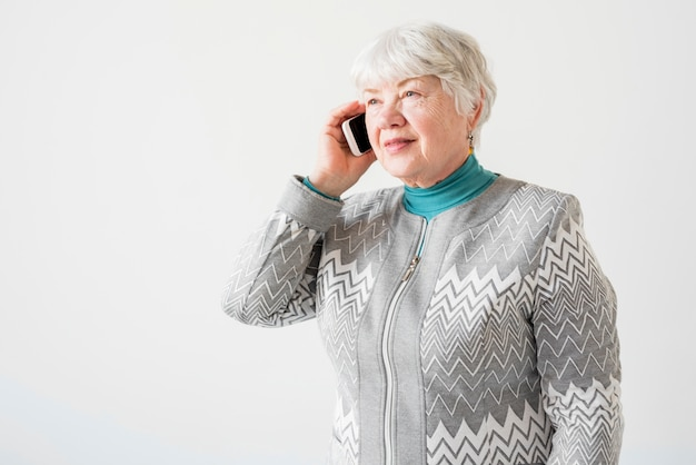 Elderly grandma talking by telephone