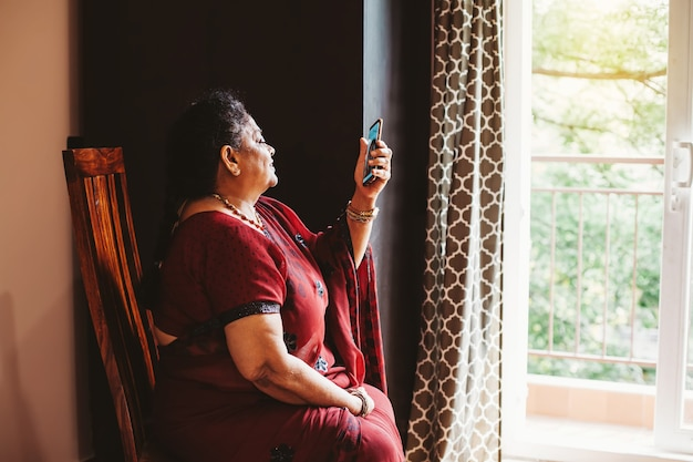 Elderly indian woman using her phone for video call