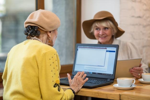 Elderly ladies with laptop