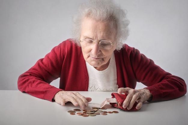 Elderly lady counting money