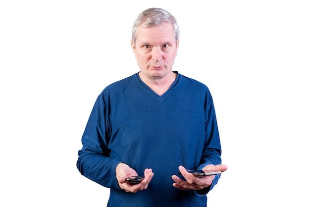 An elderly man chooses between an old telephone and a smartphone. isolated on a white background. for any purpose.