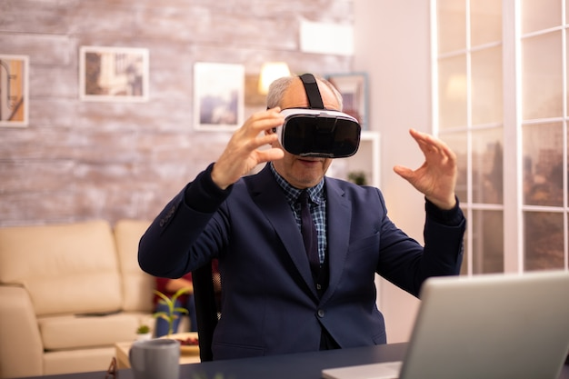 Elderly man experiencing new virtual reality technology for the first time in his home