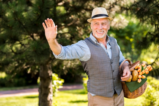 Elderly man greeting someone medium shot