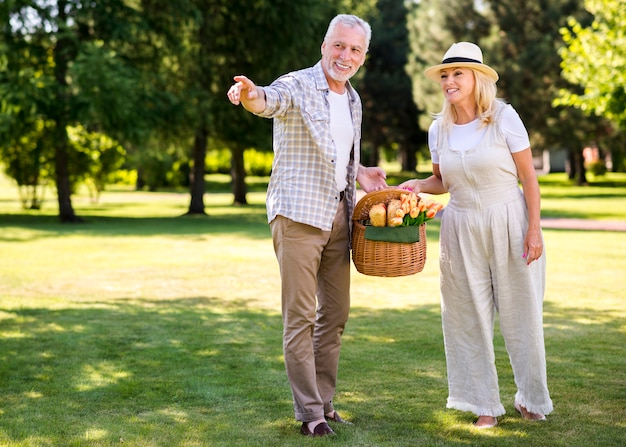 Elderly man pointing away with his woman
