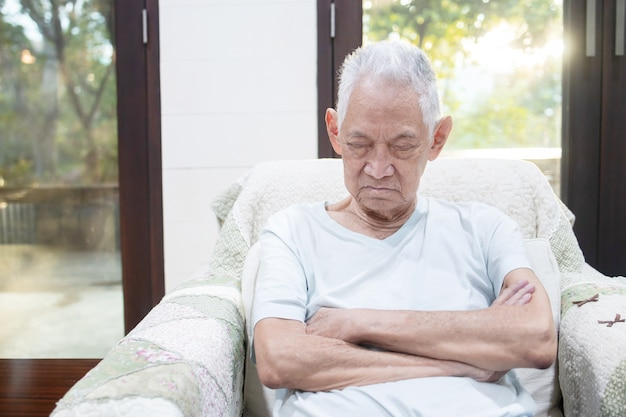 Elderly man sleeps on his sofa