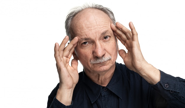Elderly man suffers from headache