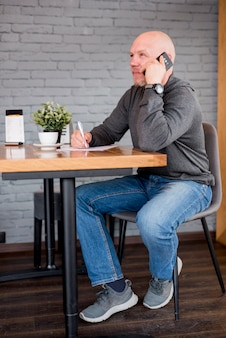 Elderly man talking by telephone