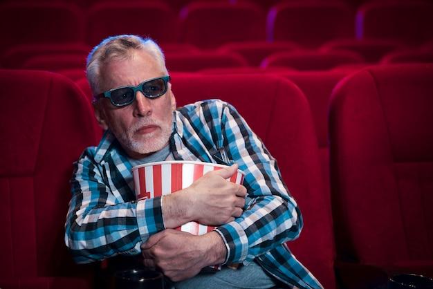 Elderly man watching movie in cinema