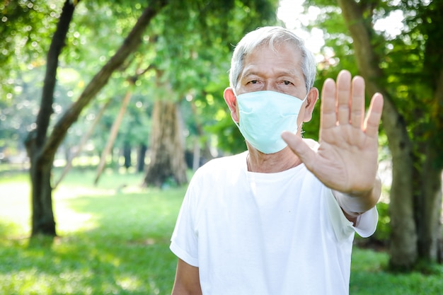 Elderly man wearing a medical mask