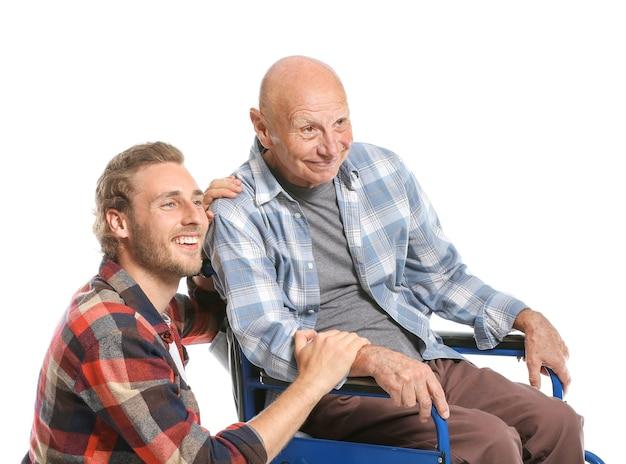 Elderly man with son on white