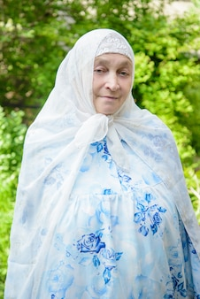 An elderly muslim woman in the garden