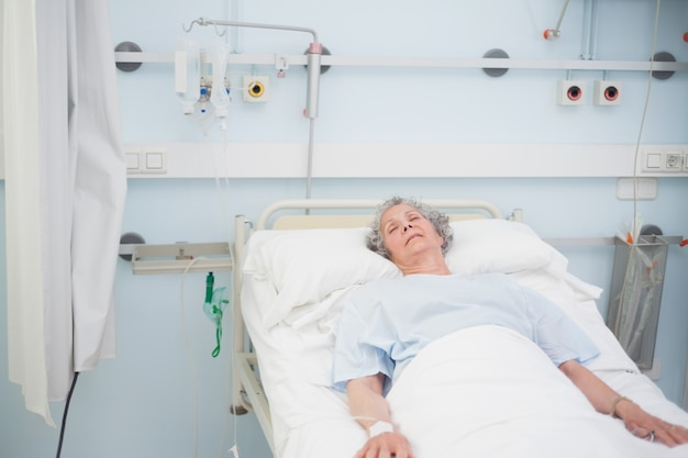 Elderly patient sleeping on a medical bed