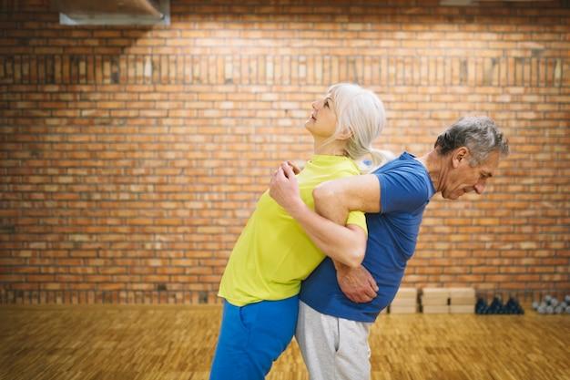 Elderly people in fitness studio